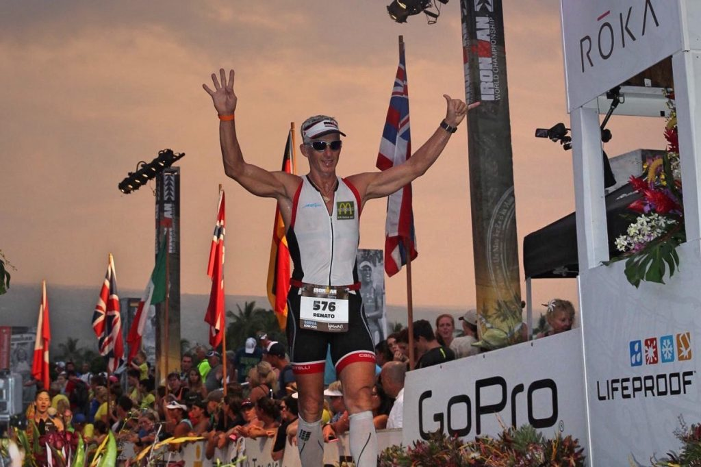 Athlete crossing the finish line at the Ironman World Championships.