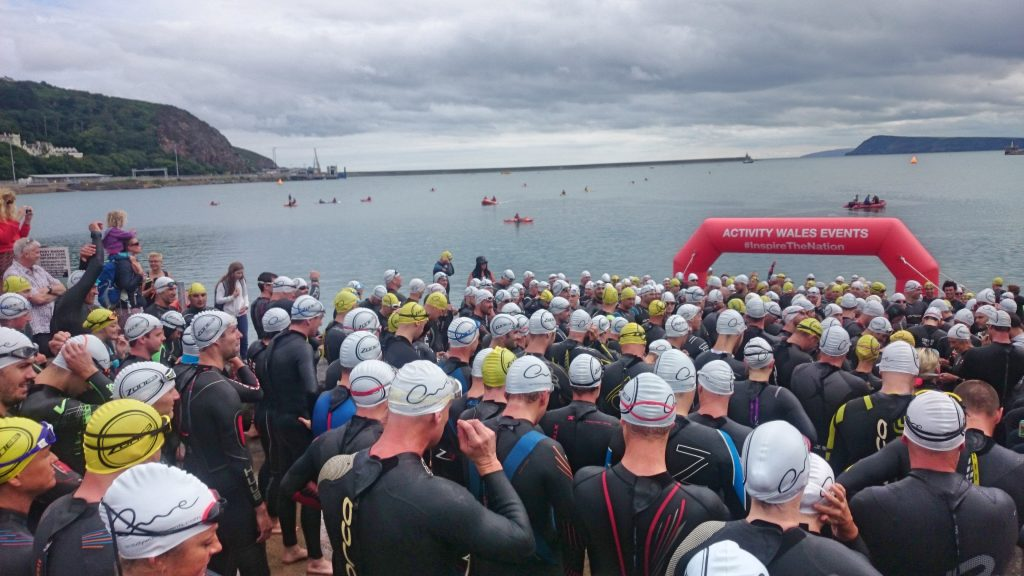 Athletes waiting to start the first leg of the triathlon - open water swim.