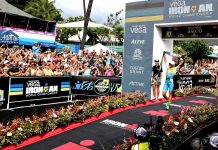 Anne Haug crosses the finish line of the 2019 Ironman World Championships